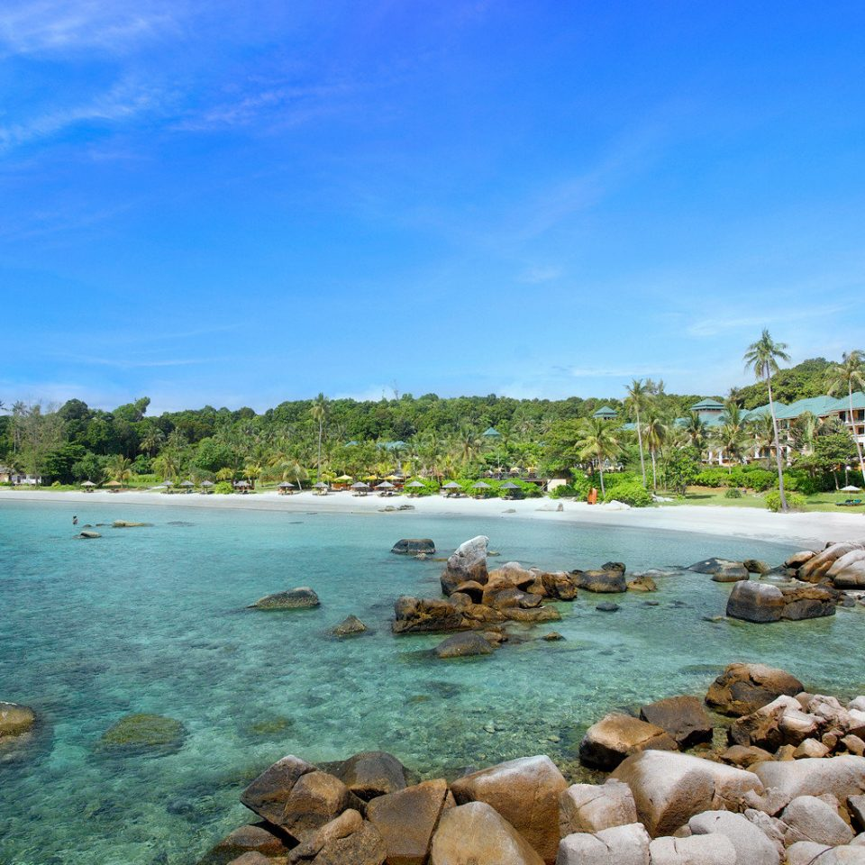 Beach Beachfront Luxury sky water rock Nature shore Sea Coast Ocean cove landscape Lagoon cape tropics surrounded