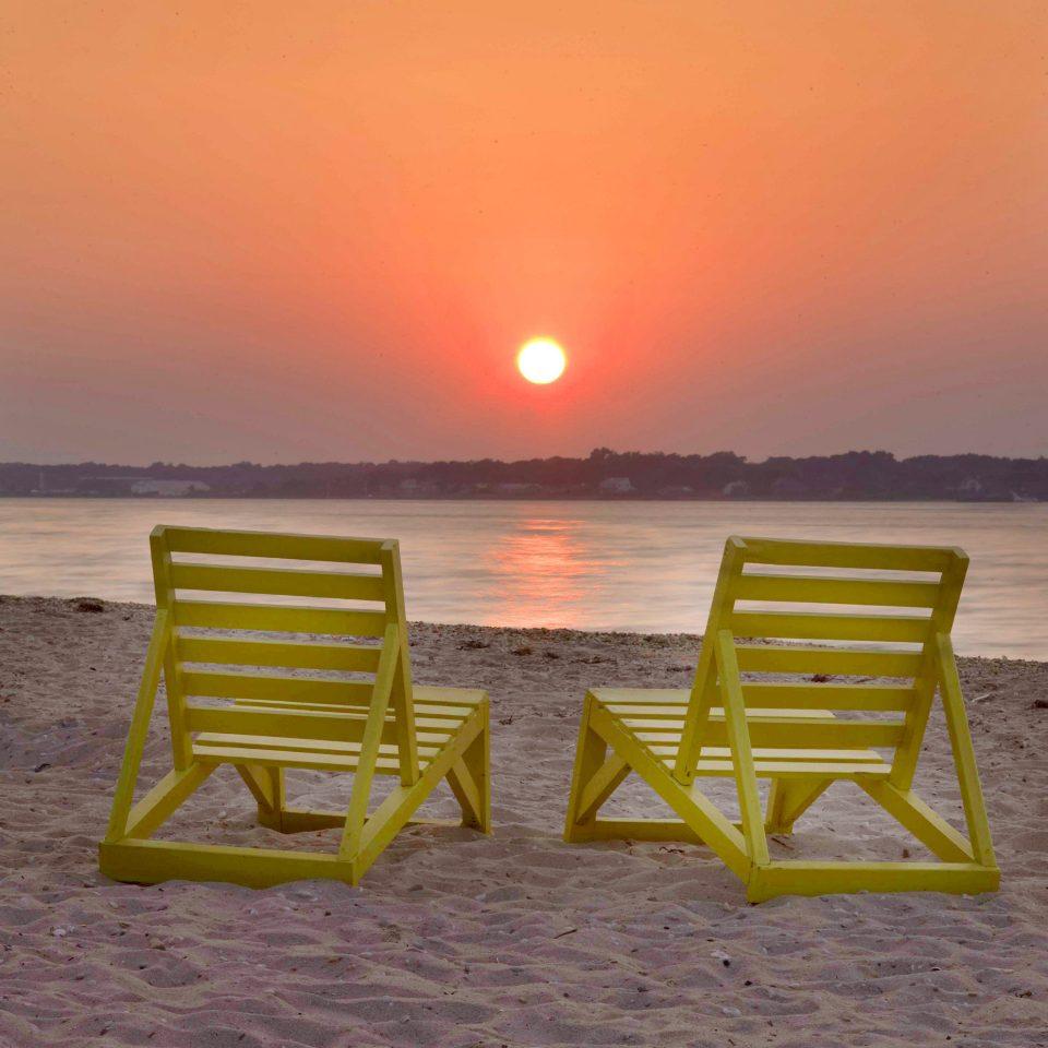 Beach Beachfront Lounge Sunset Trip Ideas water bench sky ground yellow horizon shore Sea Ocean sunrise morning chair seat sand Coast overlooking empty set sandy