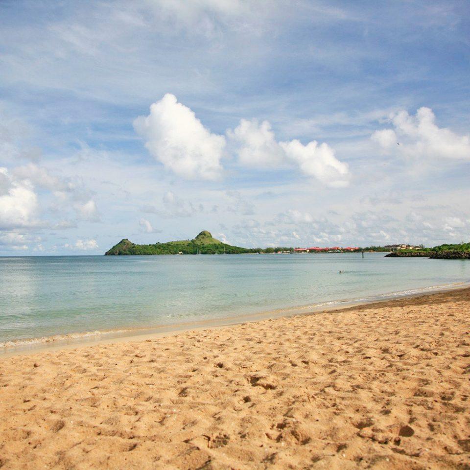 Beach Beachfront Lounge Ocean sky water shore Sea Nature horizon cloud Coast sand wave wind wave cape sandy sunlight day