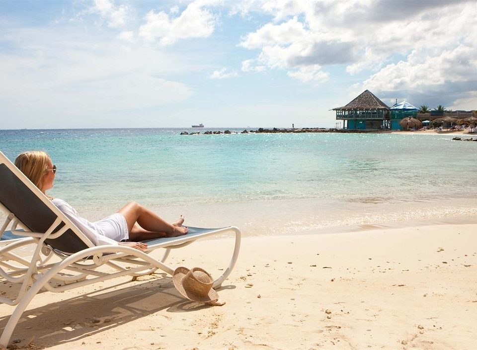 Beachfront Lounge Ocean sky Beach water ground shore Sea caribbean Coast sand long tail boat cape sandy day