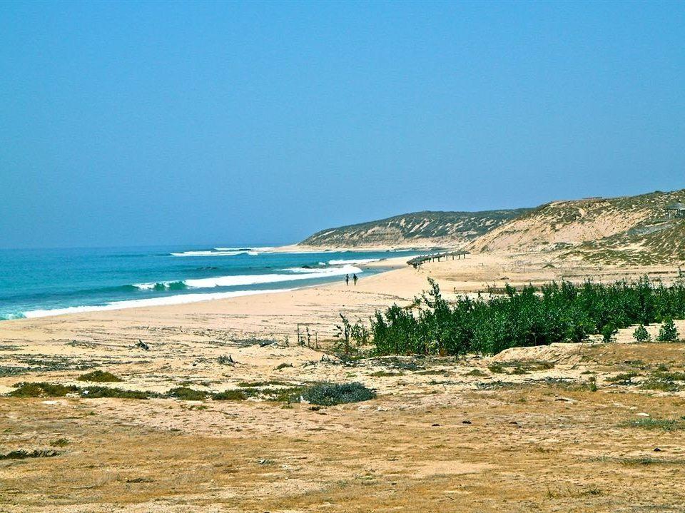 Beach Beachfront Lounge Ocean sky ground Nature Sea shore Coast horizon sand cape terrain cliff wave sandy highland