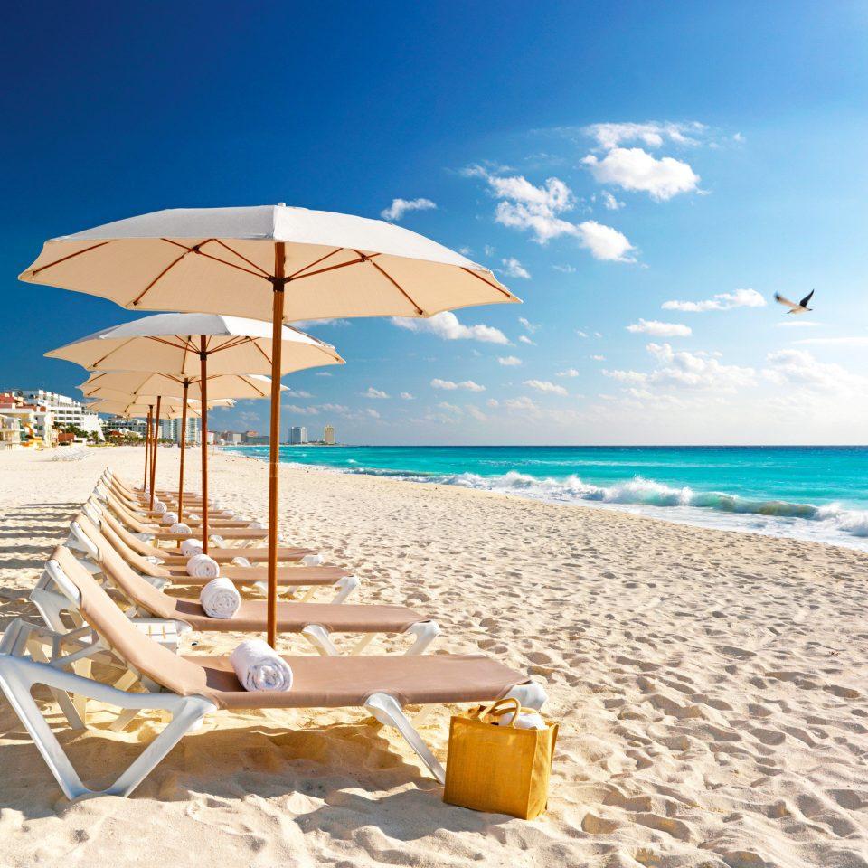 Beach Beachfront Lounge Luxury Resort sky chair umbrella Nature shore leisure Sea accessory Ocean caribbean Coast sand wind day sandy