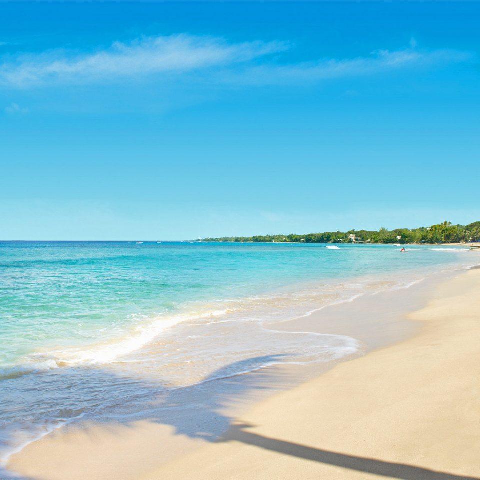 Beach Beachfront Luxury Ocean sky water shore Sea Nature Coast horizon sand wind wave wave caribbean cape day sandy