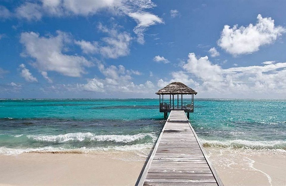 Beachfront Luxury Ocean sky water Beach shore Sea horizon caribbean Coast Nature wind wave pier wave sand cape sandy clouds day