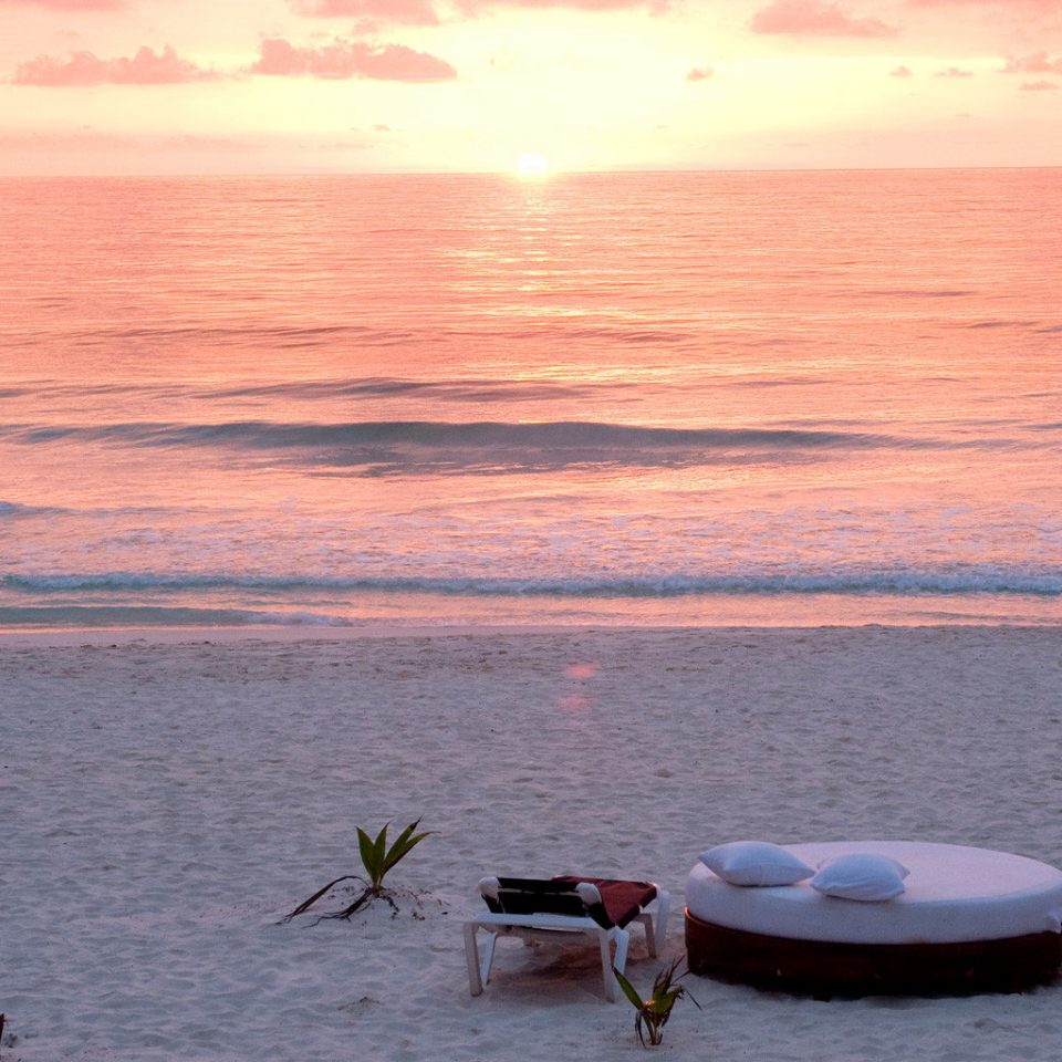Beach Beachfront Luxury Ocean Tropical water shore Sea Sunset horizon morning Coast sunrise evening wave sunlight sand dusk outdoor object sandy
