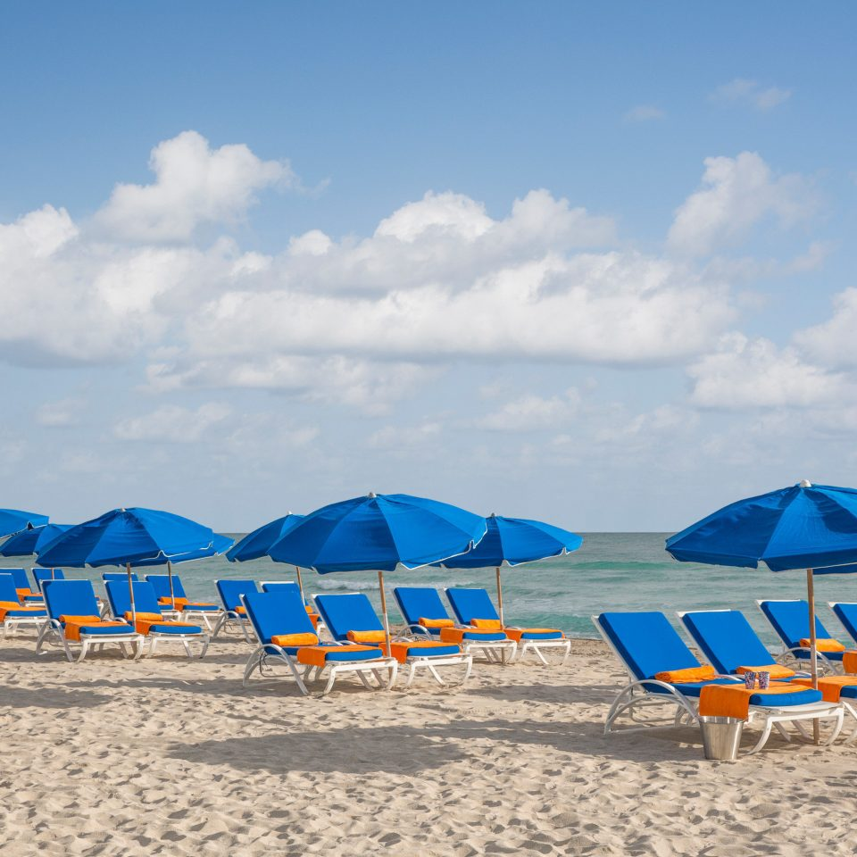 Beach Beachfront Luxury Ocean sky umbrella chair blue Sea shore atmosphere of earth Coast sand Resort aircraft day