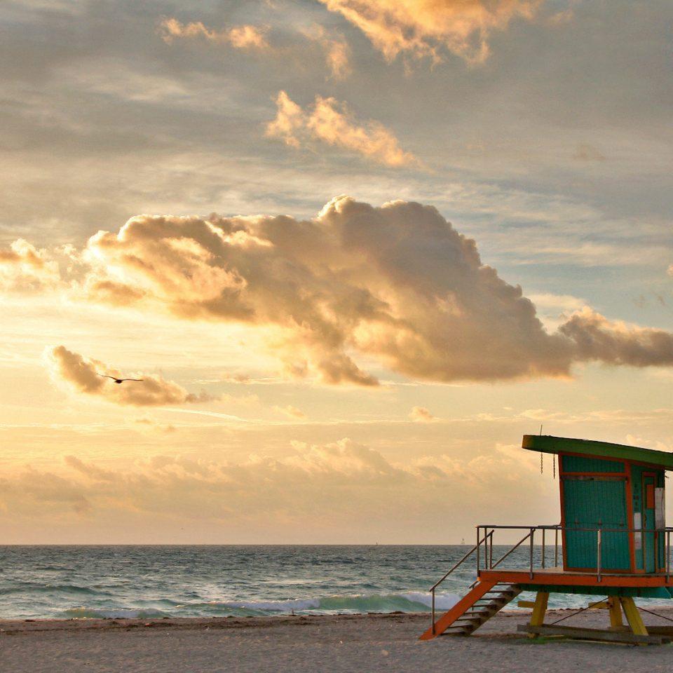 Beach Beachfront Ocean Sunset sky water shore Sea cloud horizon Coast morning evening sunrise sunlight Nature dusk wave sand dawn meteorological phenomenon clouds cloudy sandy