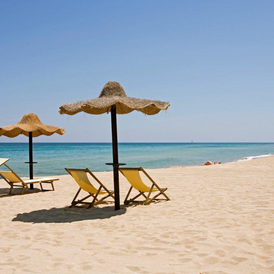 Beach Beachfront Scenic views sky water umbrella chair ground shore Sea Nature Ocean sand Coast cape sandy shade day lined