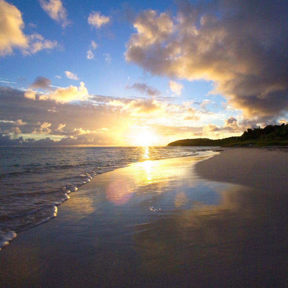 Beach Beachfront Resort Scenic views Sunset sky water clouds cloud Sea Nature horizon shore sunrise Ocean Coast Sun dawn afterglow sunlight dusk morning evening wave cloudy day sandy