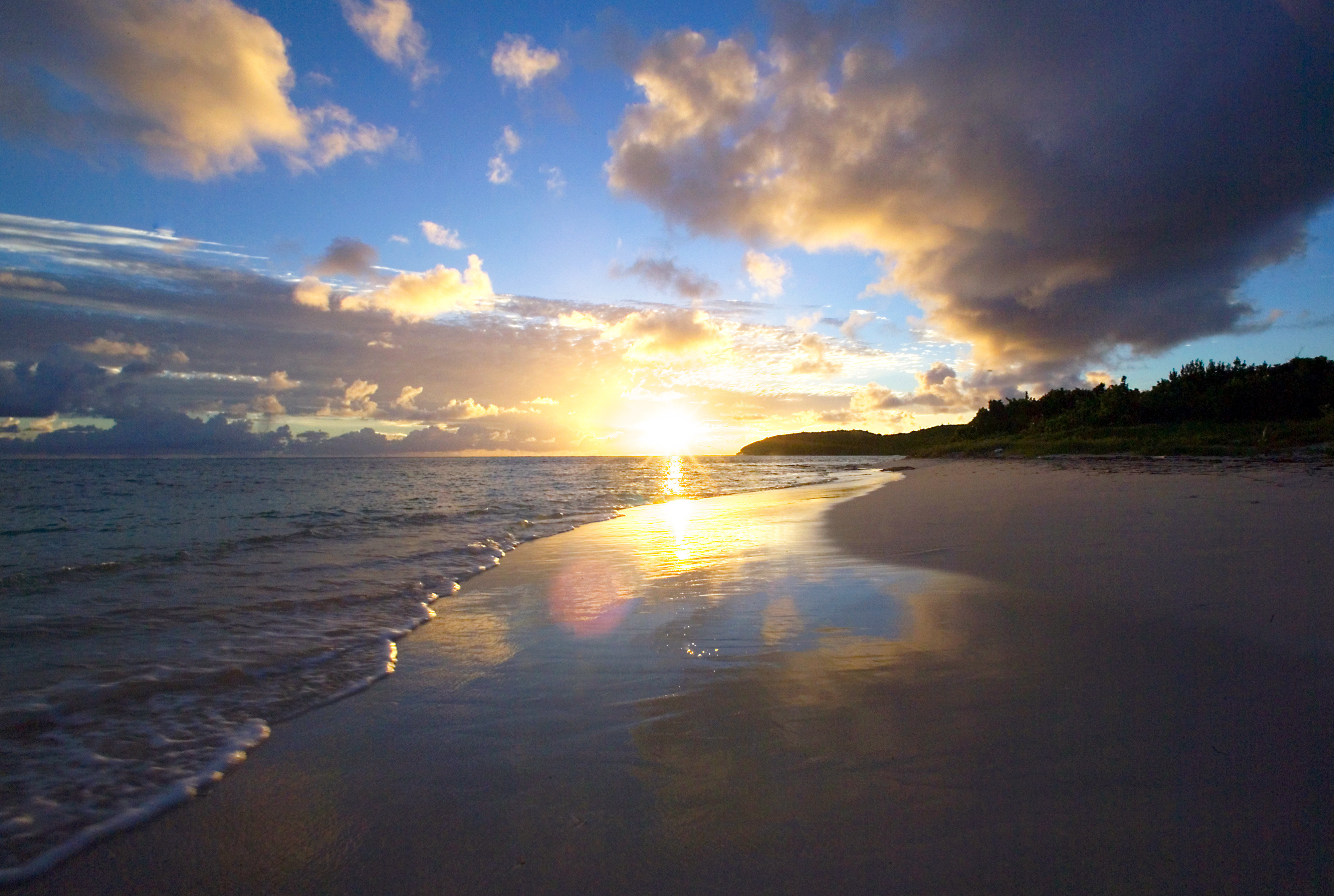 Beach Beachfront Resort Scenic views Sunset sky water clouds cloud Sea Nature horizon shore sunrise Ocean Coast Sun dawn afterglow sunlight dusk morning evening wave cloudy day sandy