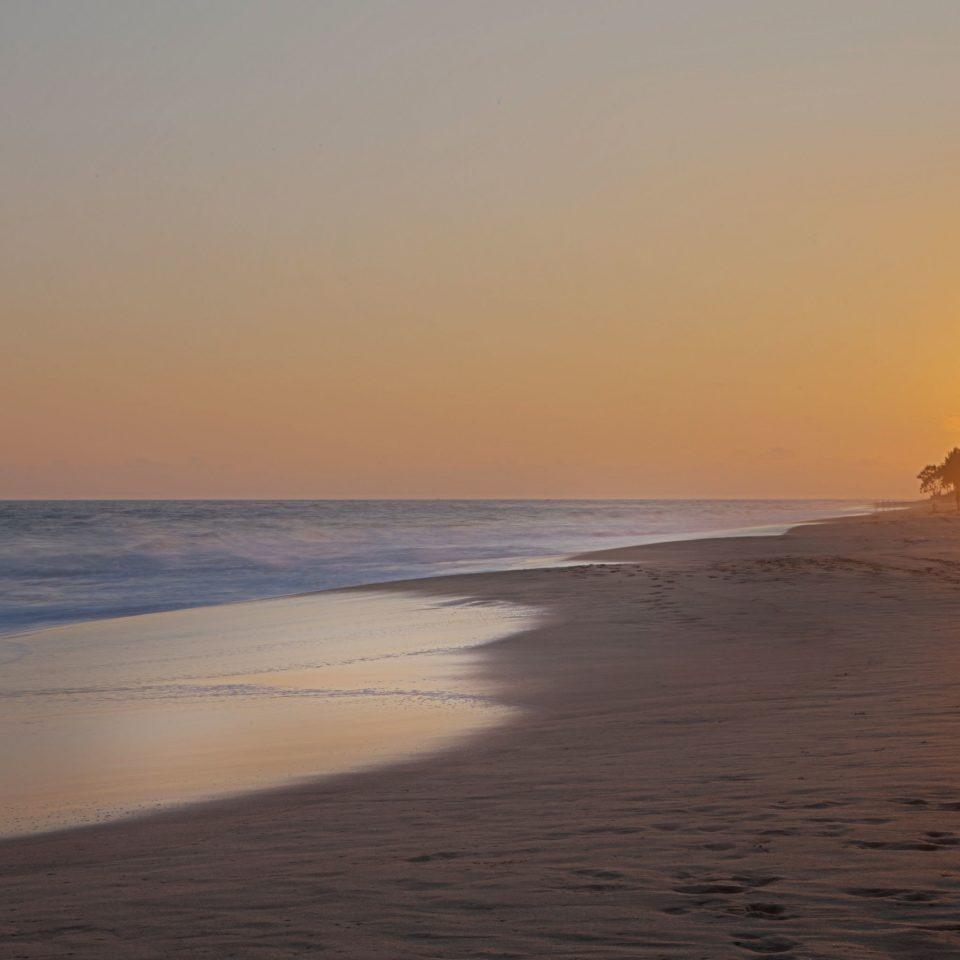 Beach Beachfront Ocean Sunset sky water Nature shore Sea horizon sunrise Coast dawn wave wind wave morning Sun dusk evening afterglow sunlight sand cape