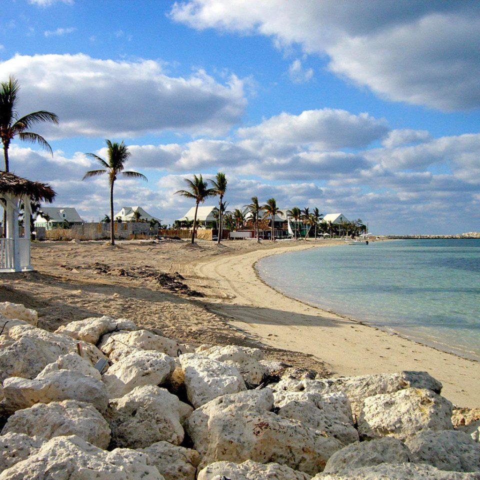Beach Beachfront Outdoors Resort Scenic views sky shore Sea Coast Ocean rock Nature cape cove sand arecales sandy day