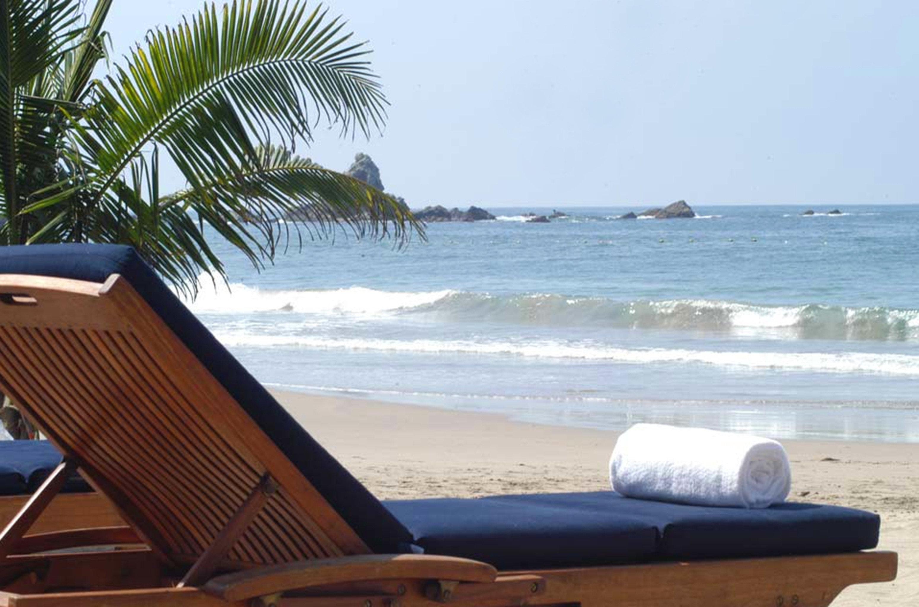 Beach Beachfront Ocean Resort Tropical Waterfront sky leisure property shore Sea Coast