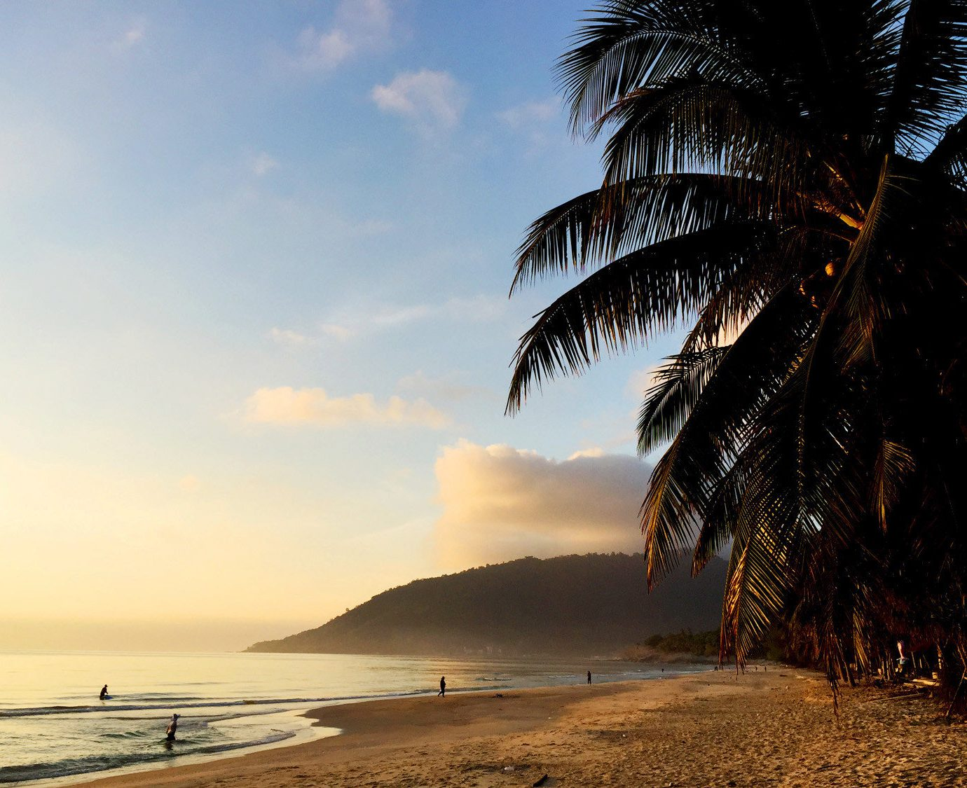 Beach Beachfront Ocean Tropical sky tree water plant Sea Coast palm morning Sunset arecales sunlight evening dusk dawn sunrise palm family tropics shore sandy shade distance