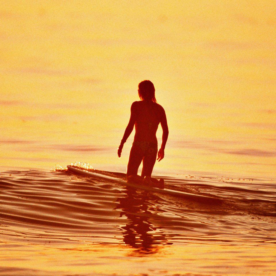 Beach Beachfront water surfing man Sunset horizon Ocean Sea standing morning wave Coast sand sunlight sunrise silhouette