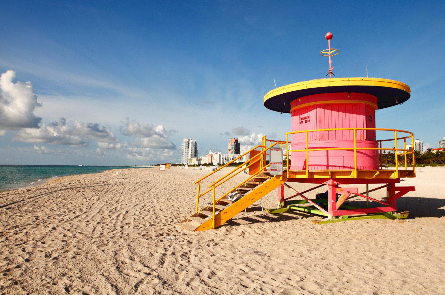 Beach Beachfront Ocean sky ground Sea Coast sand shore vehicle yellow tower
