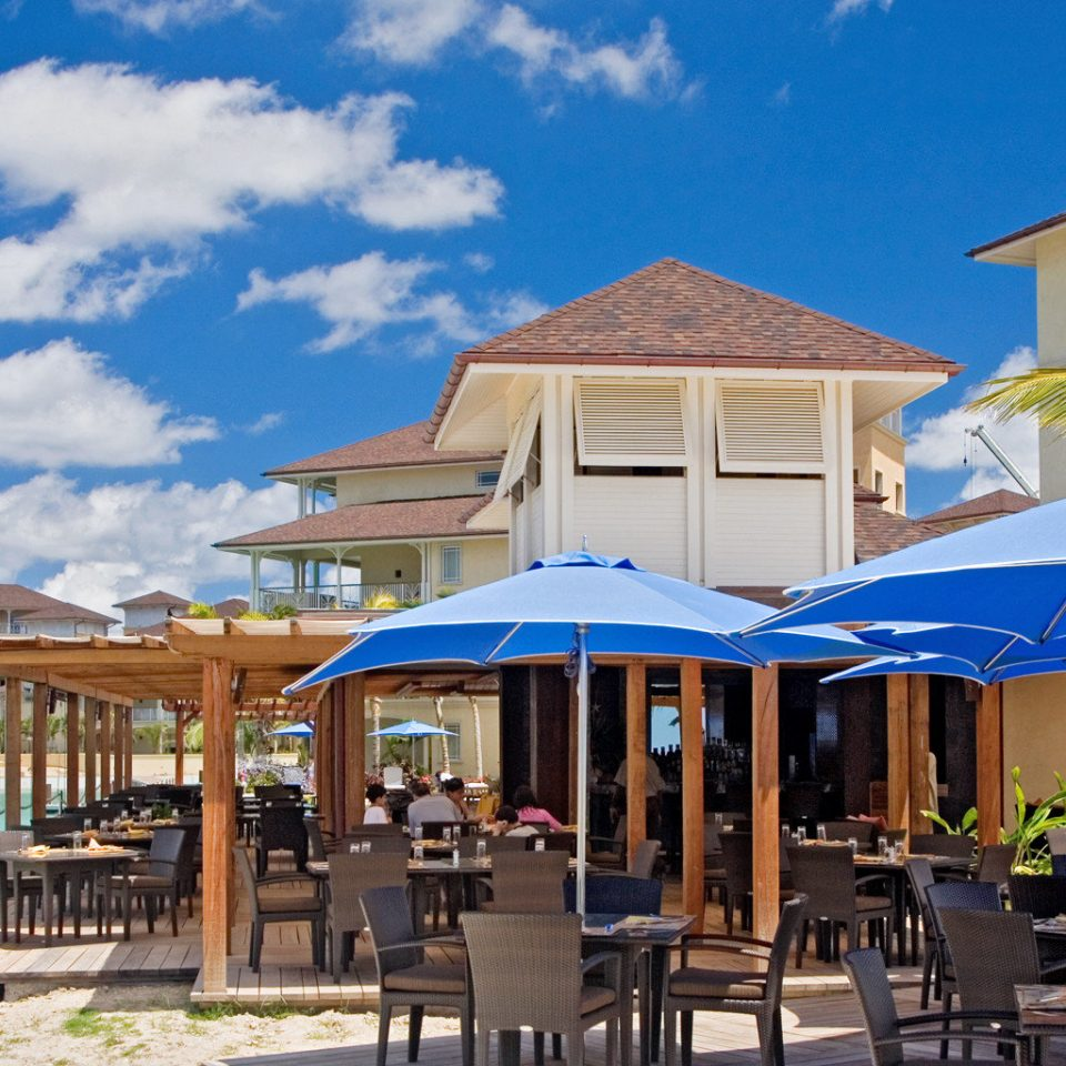 Beach Beachfront Dining Drink Eat Grounds Hotels Island Romance chair sky umbrella leisure property Resort Deck lawn wooden restaurant Villa set shore