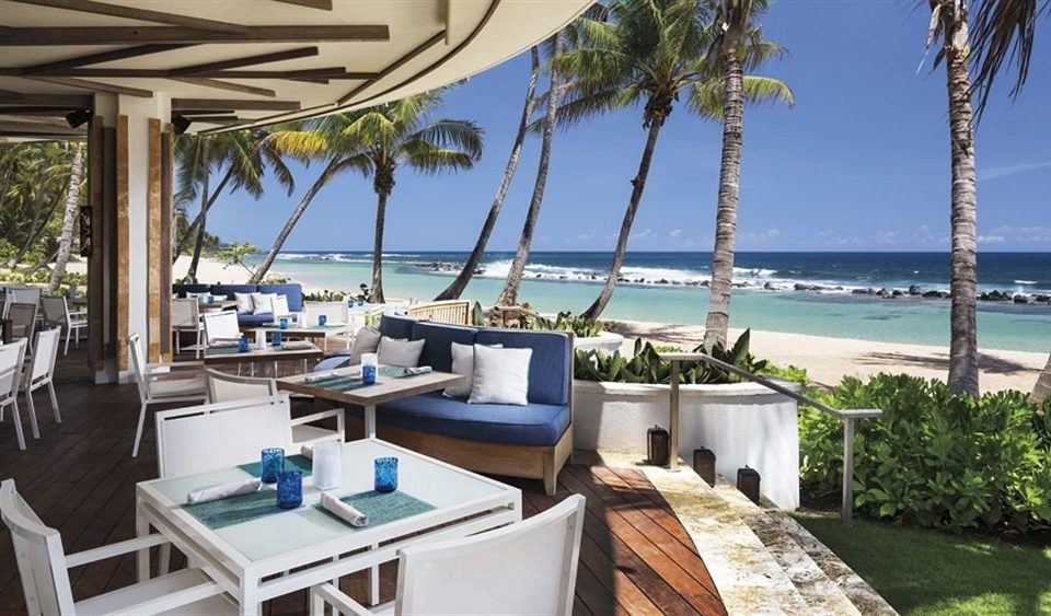 Beach Beachfront Dining Drink Eat Luxury Resort tree sky property chair caribbean Villa restaurant marina condominium cottage overlooking Deck shore Island