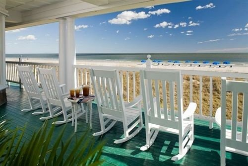 Beach Beachfront Lounge Luxury chair property lawn Deck Ocean porch white home Resort Villa caribbean Dining cottage outdoor structure Pool set shore