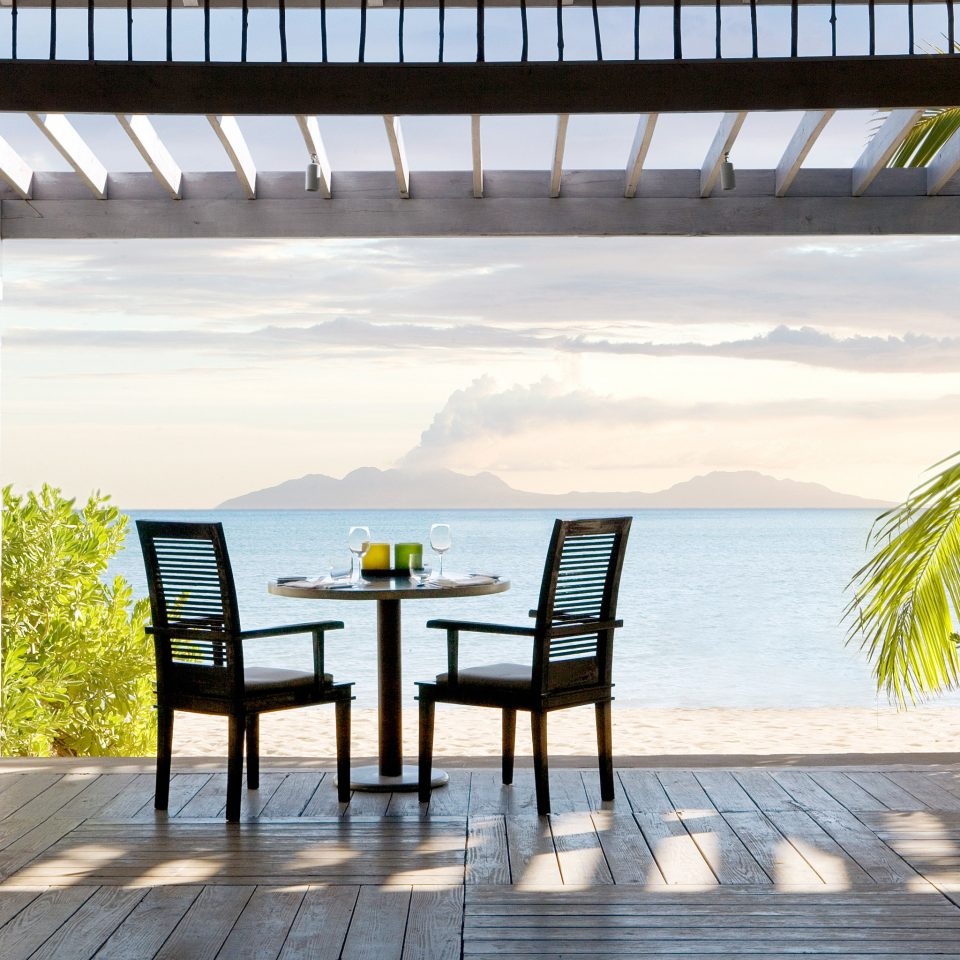 Beach Beachfront Deck Drink Eat Island Luxury Resort Scenic views Tropical ground property building walkway home outdoor structure Villa cottage porch day