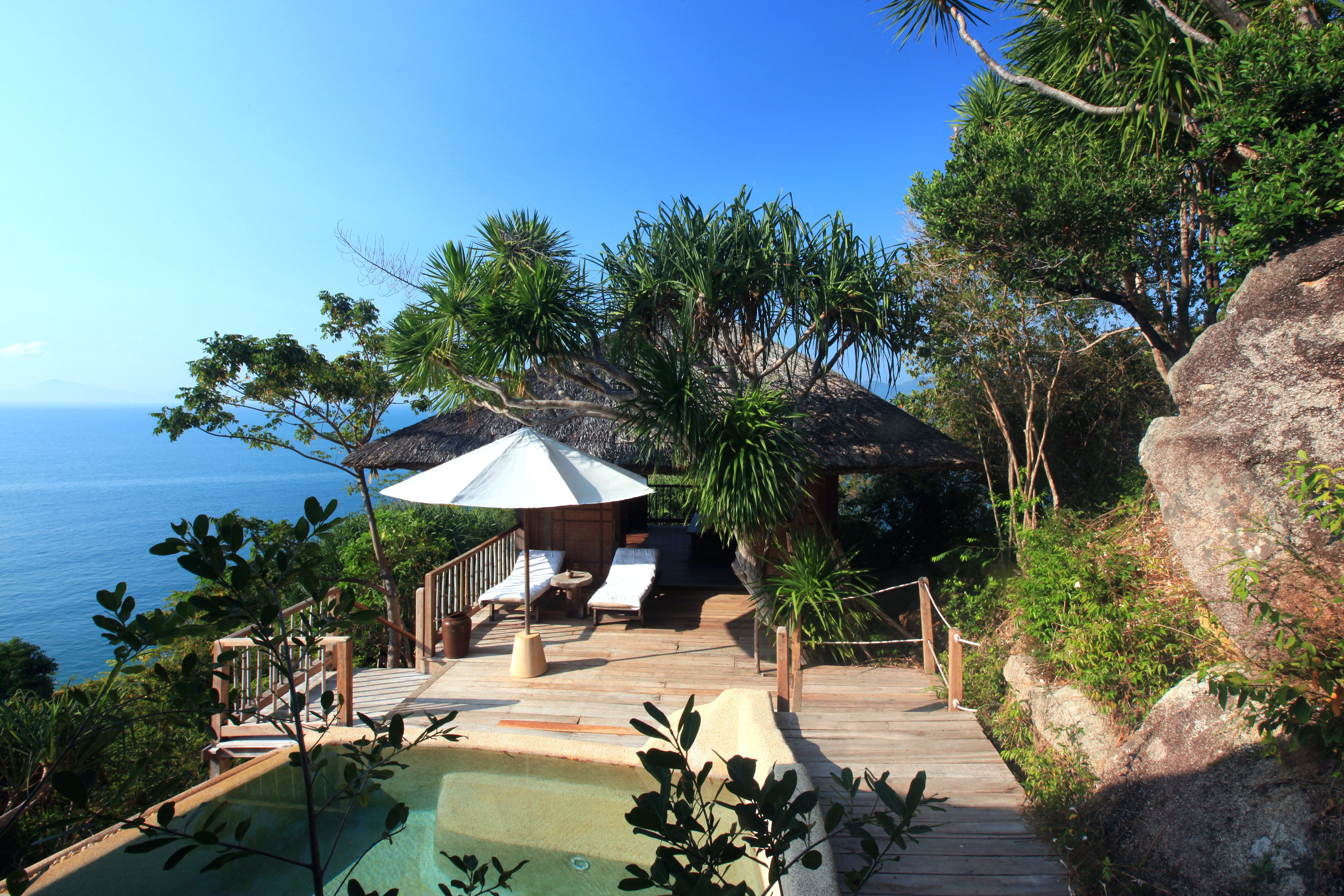 Beachfront Deck Eco Jungle Romance Scenic views Tropical Waterfront tree sky Resort palm Beach arecales tropics plant Villa Sea Village