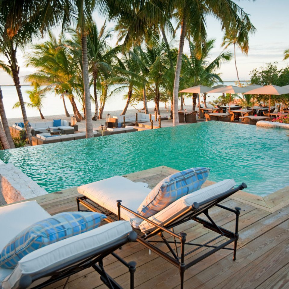 Beachfront Eco Luxury Play Pool Resort Romance Scenic views tree sky leisure chair swimming pool property Beach caribbean Villa wooden empty overlooking Deck lined shade
