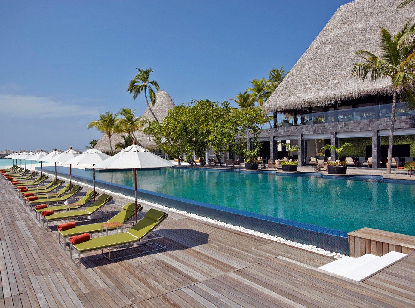 Beachfront Elegant Luxury Modern Pool Villa swimming pool chair leisure property Resort walkway caribbean Beach Sea boardwalk lined Deck
