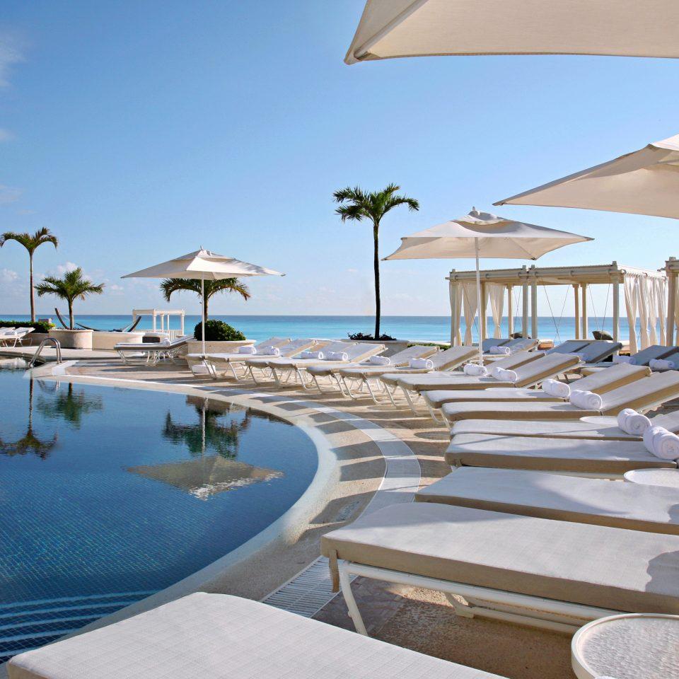 Beachfront Exterior Lounge Luxury Pool Romantic sky chair swimming pool Resort property leisure marina dock caribbean Villa Beach condominium Sea Deck