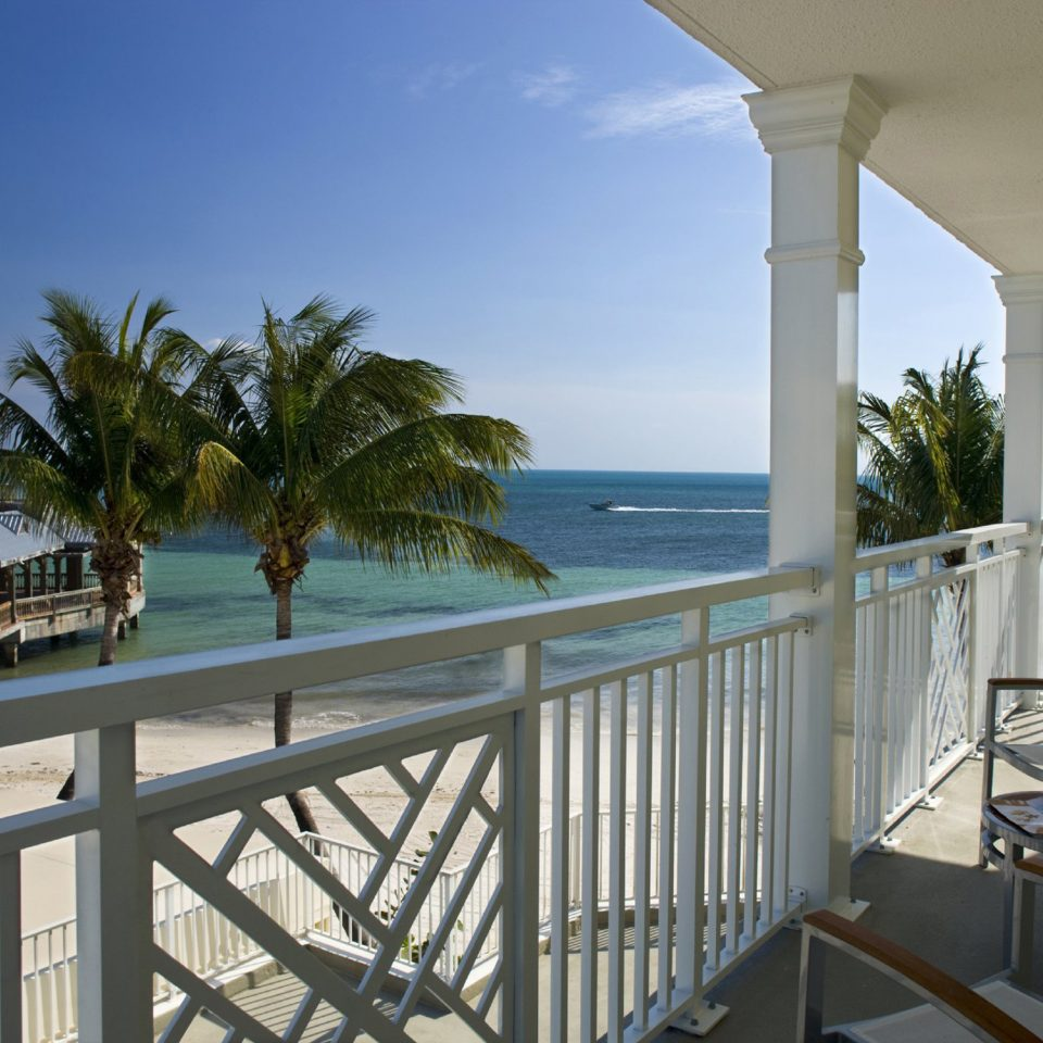 Beach Beachfront Exterior Grounds Ocean Tropical sky building property Deck Resort caribbean overlooking Villa porch condominium home Sea swimming pool cottage