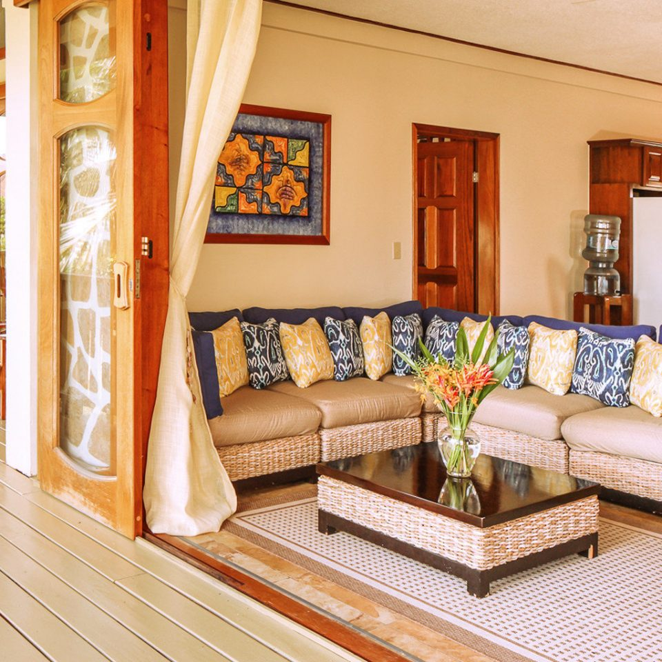 Beach Beachfront Deck Family Island Kitchen Lounge Resort Tropical Villa Waterfront property living room home hardwood cottage Suite mansion