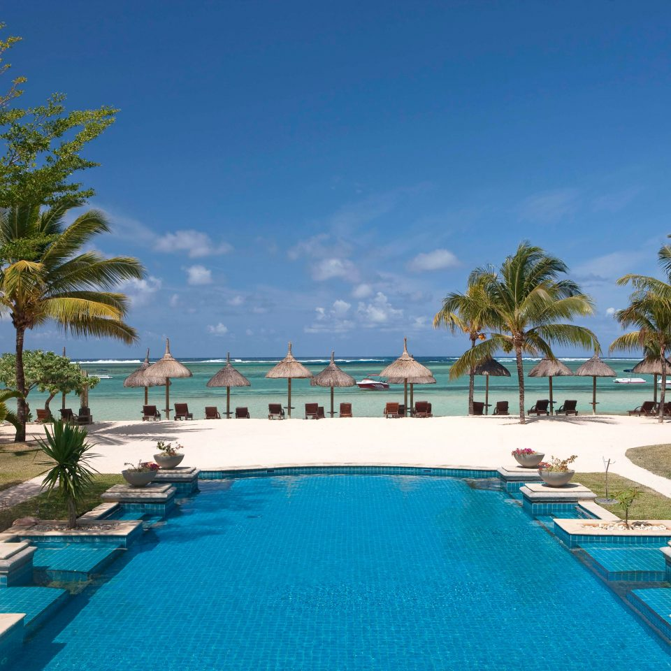 Beach Beachfront Island Luxury Pool Romance Romantic tree sky Resort Golf palm swimming pool property leisure lawn resort town Villa caribbean lined Lagoon condominium marina Water park reef swimming shade Deck sandy day colonnade