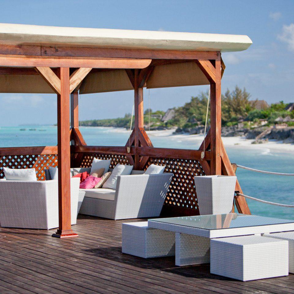 Beach Beachfront Deck Honeymoon Resort Scenic views sky ground chair leisure wooden outdoor structure swimming pool Villa cottage overlooking