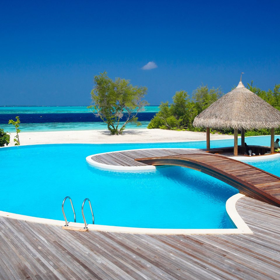 Beach Beachfront Island Pool water swimming pool property leisure Villa Resort swimming Nature backyard caribbean Lagoon Deck lined