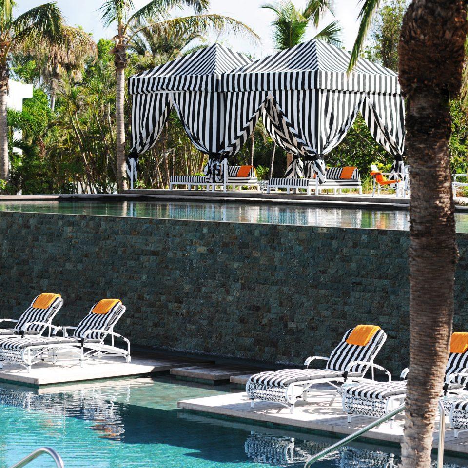Beach Beachfront Deck Island Lounge Pool Scenic views Trip Ideas Waterfront tree leisure swimming pool Resort