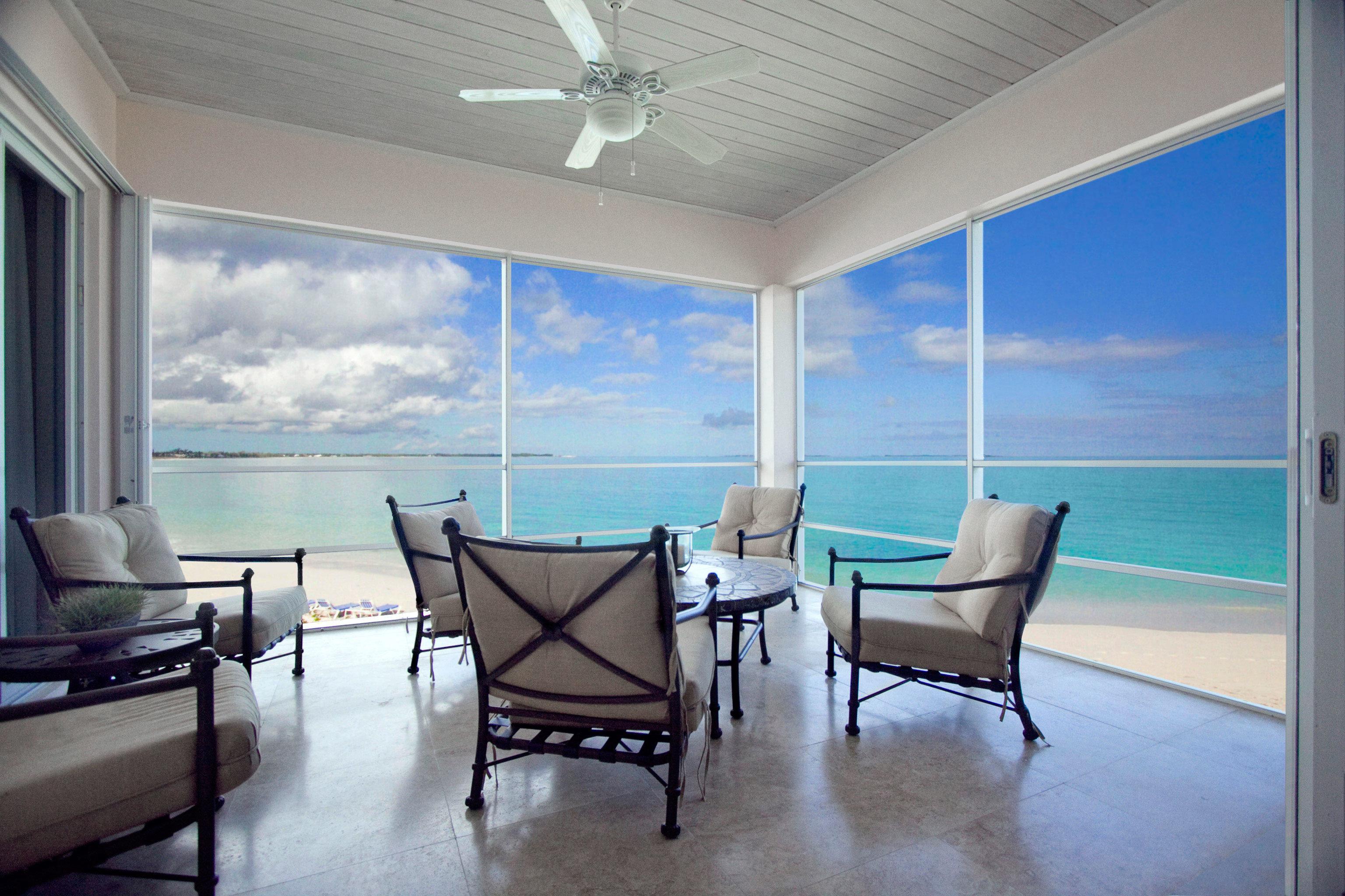 Beach Beachfront Lounge Patio Resort property building chair house home condominium living room porch Villa Suite Deck