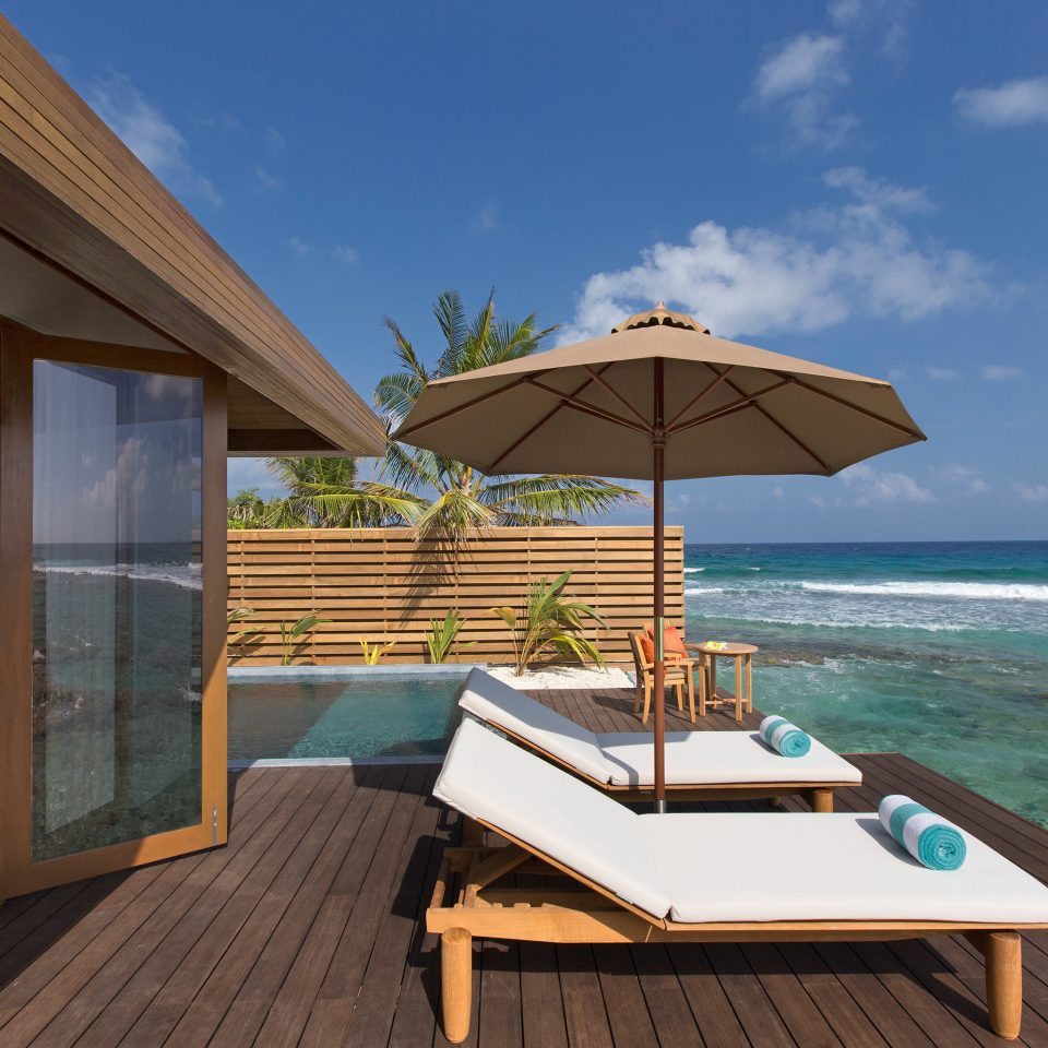 Beach Beachfront Lounge Luxury sky property leisure Resort Deck Villa swimming pool home cottage caribbean open shore overlooking day