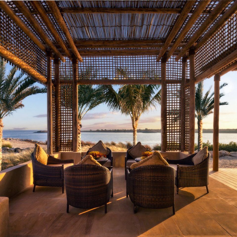 Beach Beachfront Deck Lounge property building Resort Villa home outdoor structure cottage porch hacienda