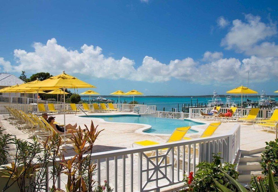 Beach Beachfront Luxury Modern Pool sky umbrella yellow leisure chair Resort caribbean Nature resort town swimming pool Water park Sea shore Deck day