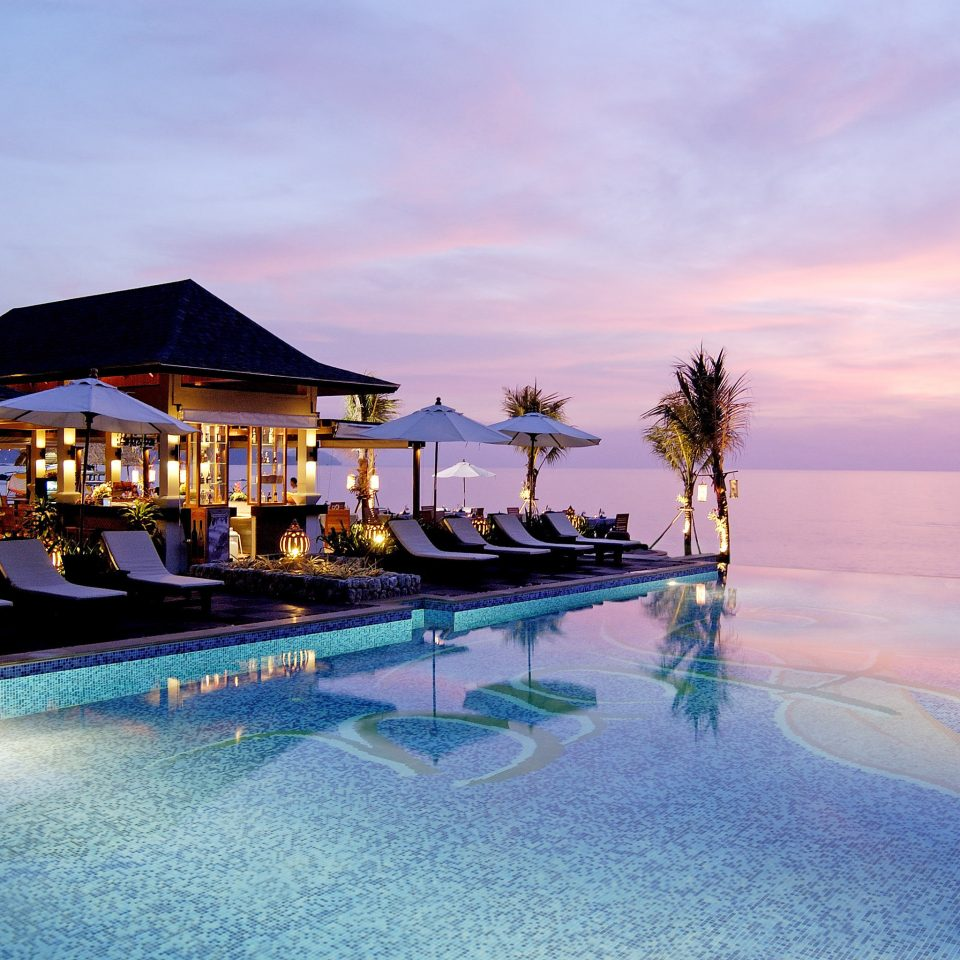 Beachfront Deck Pool Romantic Scenic views water sky Resort swimming pool Sea Ocean evening dusk Beach shore day