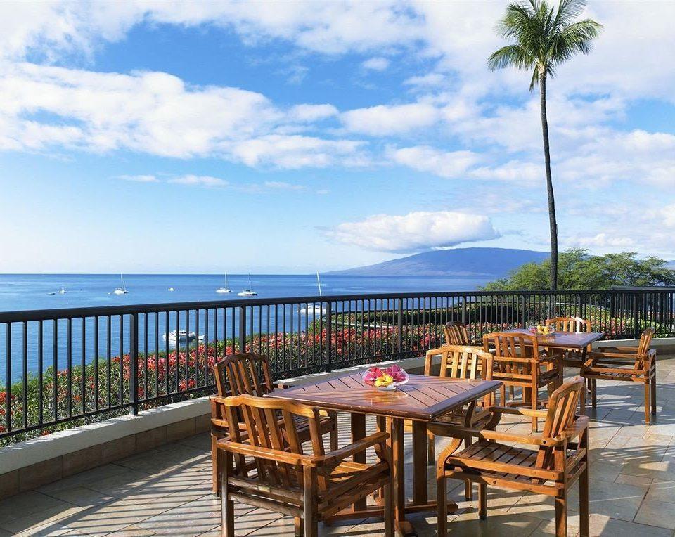 Beach Beachfront Ocean sky chair property leisure wooden Resort caribbean walkway Villa condominium Sea cottage Deck day