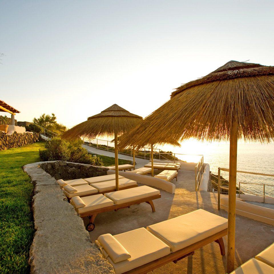 Beach Beachfront Deck Resort Romance Scenic views Wellness sky Villa cottage hut lawn lined sandy day