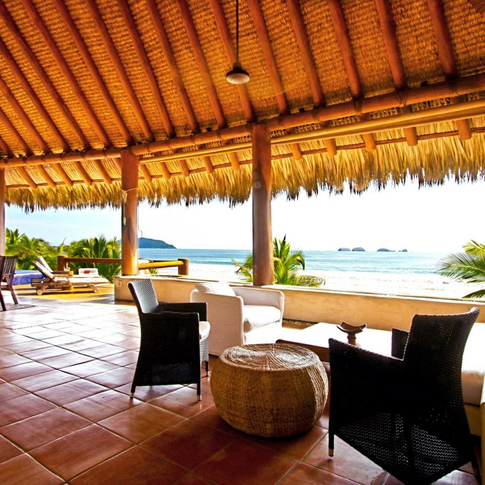 Beach Beachfront Deck Scenic views chair Resort property Villa hacienda eco hotel restaurant