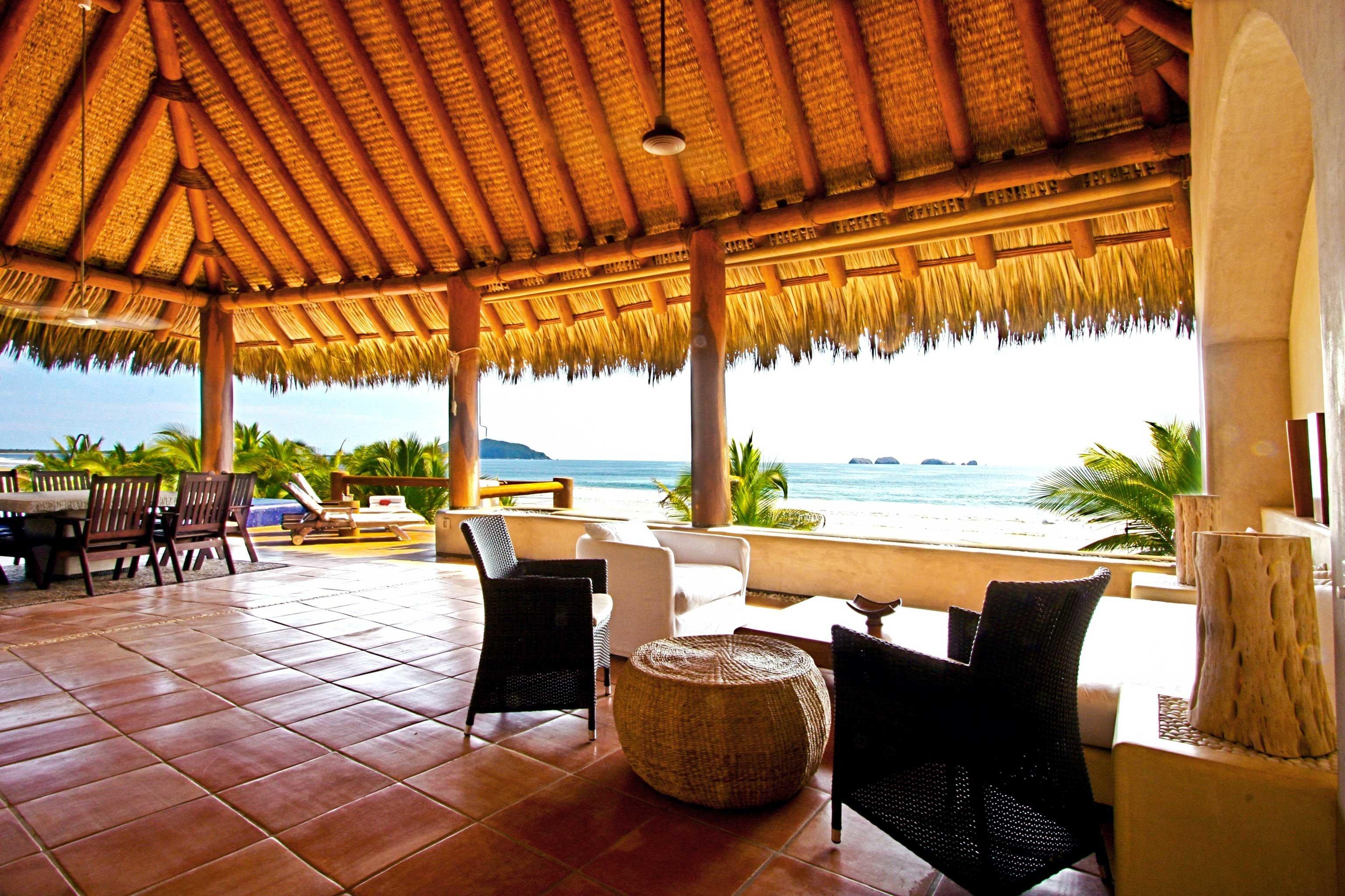 Beach Beachfront Deck Scenic views chair Resort property Villa hacienda eco hotel restaurant