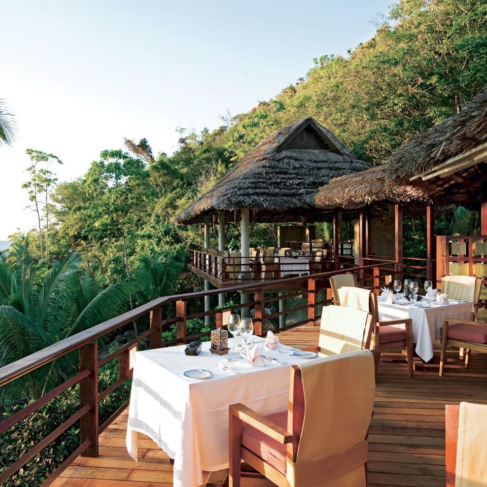 Beach Beachfront Dining Drink Eat Grounds Island Jungle Scenic views tree building Resort restaurant