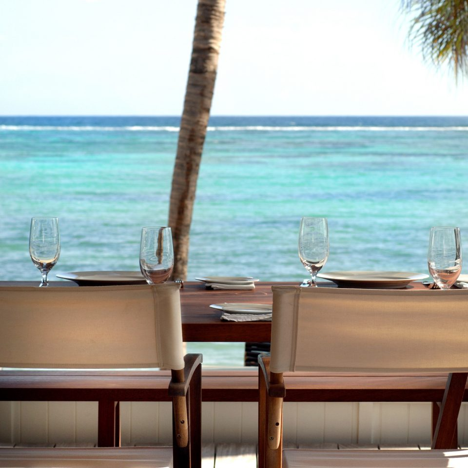 Beach Beachfront Dining Drink Eat Honeymoon Luxury Romance Romantic water sky property Ocean swimming pool caribbean shore Nature restaurant Resort Villa overlooking yacht