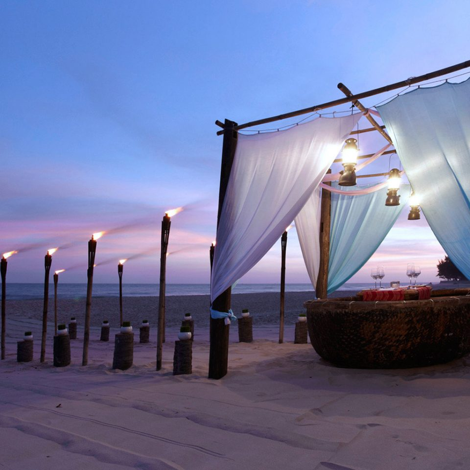 Beachfront Dining Drink Eat Grounds Honeymoon Jungle Ocean Outdoors Resort Spa Sunset Tropical sky blue light Sea Beach morning evening sunlight shape dusk
