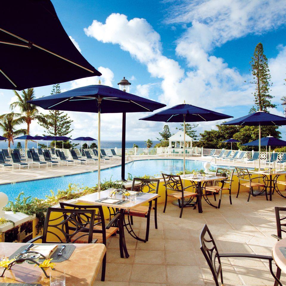 Beachfront Dining Drink Eat Hotels Play Pool sky umbrella chair leisure lawn Resort restaurant Beach set caribbean shade swimming