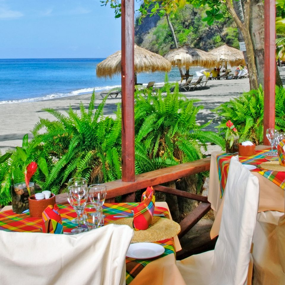 Beach Beachfront Dining Drink Eat Island Luxury Resort Scenic views tree wedding ceremony caribbean restaurant flower colorful