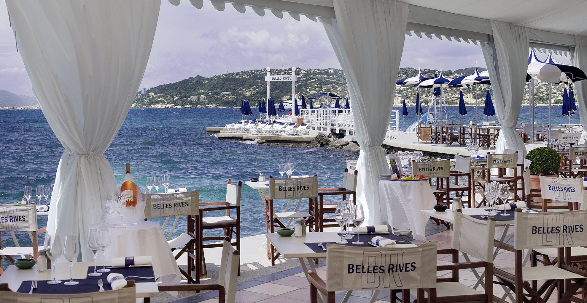 Beach Beachfront Dining Drink Eat Scenic views marina restaurant dock vehicle yacht Resort day