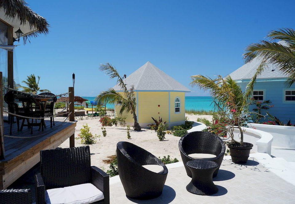 Beachfront Dining Lounge Luxury Resort Tropical tree leisure building home Beach Villa plant palm Garden